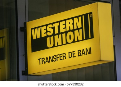 Bucharest, Romania, November 15, 2009: Western union money transfer neon advertisement.