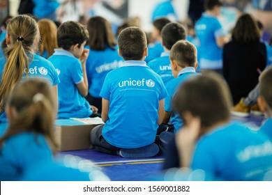Bucharest, Romania - November 19, 2019: Children wearing Unicef shirts take part at an event. Unicef logo.