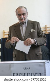Bucharest, Romania, November 22, 2009: Politician and business man Dinu Patriciu votes for the presidential elections, in a polling station in Bucharest.