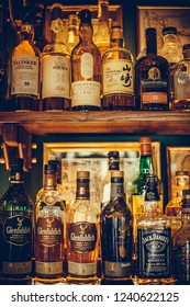 Bucharest Romania - November 22, 2018: Illustrative-editorial shot of various bottles of alcohol displayed in bar in Bucharest, Romania.