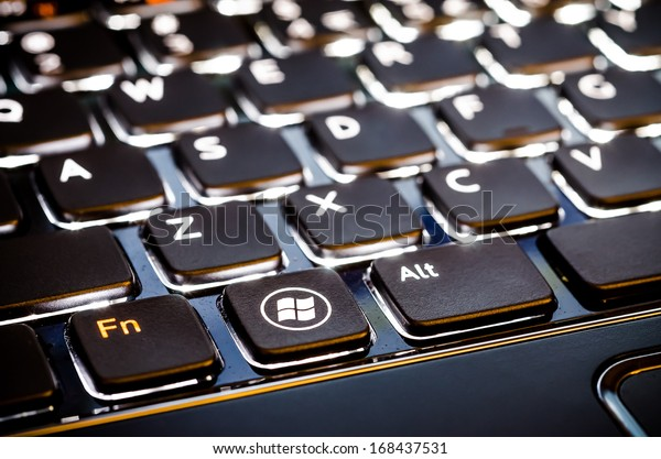 BUCHAREST, ROMANIA - NOVEMBER 30, 2012: Microsoft Keyboard With Special Microsoft Windows 8 Button Design. Released on 1 August 2012, Windows 8 is the latest operating system available from Microsoft.