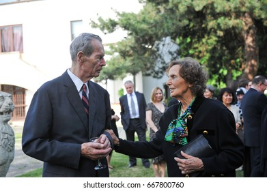 BUCHAREST, ROMANIA - NOVEMBER 8, 2013: King Michael of Romania and Queen Anne attend a garden party on November 8, 2013 in Bucharest.