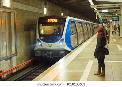 BUCHAREST, ROMANIA - OCT 06, 2016: People waiting for an arriving subway train in Bucharest, Romania