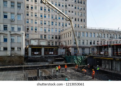 Bucharest, Romania, October 16, 2018: Casting foundation with concrete pump on the site of the first NGO crowdfunded public hospital in Romania.