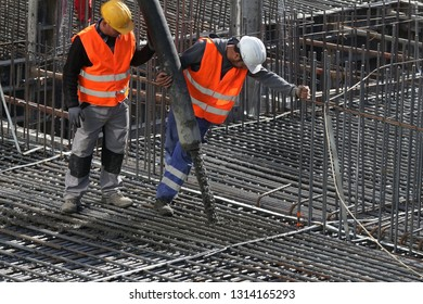 Bucharest, Romania - October 16, 2018: Construction workers pour concrete at the foundation of the first oncology hospital for children in Romania, in Bucharest. This image is for editorial use only.