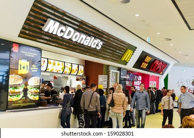 BUCHAREST, ROMANIA - OCTOBER 18: People buying fast-food from McDonald's Restaurant on October 18, 2013 in Bucharest, Romania. McDonald's is the main fast-food restaurant chain in Romania.