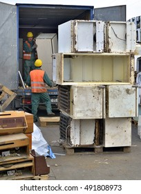 Bucharest, Romania - October 2013: Workers sorting electronic waste from a newly arrived trailer, ready to be recycled on a recycling plant