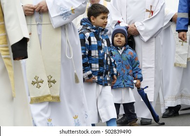 BUCHAREST, ROMANIA - OCTOBER 23, 2016: Altar servers are participating at the Eucharistic procession with the relic of Saint Pope John Paul II.