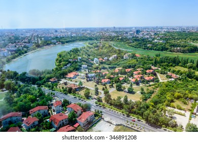 BUCHAREST, ROMANIA - OCTOBER 25, 2015: Bucharest North Side, Herastrau Lake and Park (Parcul HerÃ??strÃ??u) is a large park on the northern side of Bucharest, Romania, around Lake HerÃ??strÃ??u.