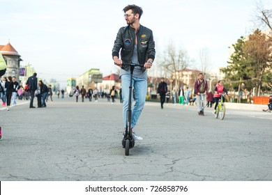 BUCHAREST, ROMANIA, - October 26, 2017: Man Using Electric Scooter on the park on a sunny day with sarf effect and blurry.