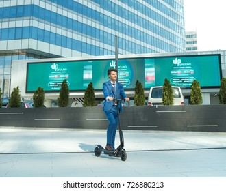 BUCHAREST, ROMANIA, - October 26, 2017: Using Electric Scooter on the street on a sunny day with sarf effect and blurry. Editorial content.