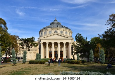 Bucharest, Romania - October 28, 2018:  People enjoy time in front of `George Enescu` Philharmonic, landmark of Romanian capital city on a beautiful autumn day.