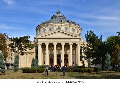 Bucharest, Romania - October 28, 2018:  People enjoy time in front Romanian Athenaeum concert hall, home of `George Enescu` Philharmonic, landmark of Romanian capital city on a beautiful autumn day.