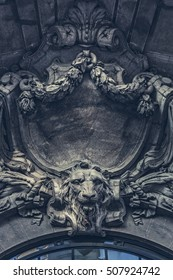 Bucharest, Romania - October 3, 2013: Architectural detail of stone carved ornaments with lion head on the sumptuous classic French style frontispiece of the Stock Exchange Palace.