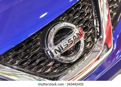 BUCHAREST, ROMANIA - OCTOBER 31, 2014: Nissan Sign Close Up. Founded in 1933 Nissan is a Japanese multinational automobile manufacturer headquartered in Yokohama, Japan.