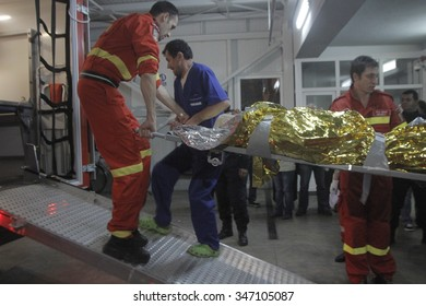 Bucharest, Romania, October 31, 2015: Romanian paramedics transfer a wounded person, who survived from a fire at a Colectiv Club from the Emergency Hospital Floreasca to a burn center.