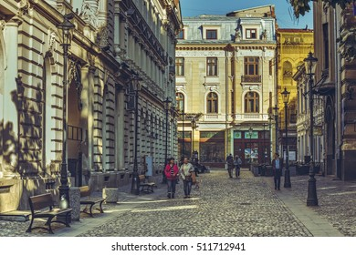 Bucharest, Romania - October 6, 2013: Tourists wander the cobblestone streets of the historic center Lipscani, the Bucharest's liveliest entertainment district.