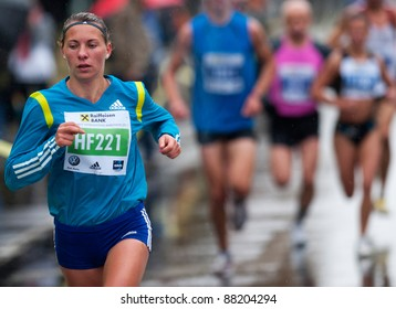 BUCHAREST, ROMANIA - OCTOBER 8: An unidentified marathon runner competes at the Bucharest International Marathon 2011, October 8, 2011 in Bucharest, Romania