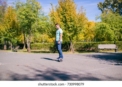 BUCHAREST, ROMANIA, - October 9, 2017: Using Electric Hoverboard on the park in a sunny day with bokeh effect and blurry. Illustrative editorial content.