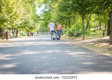 BUCHAREST, ROMANIA, - Octomber 26, 2017: Man Using Electric Hoverboard on the park on a sunny day with sarf effect and blurry. Editorial content.
