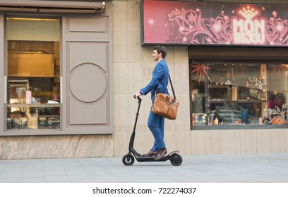 BUCHAREST, ROMANIA, - Octomber 26, 2017: Using Electric Scooter on the street on a sunny day with sarf effect and blurry. Editorial content.