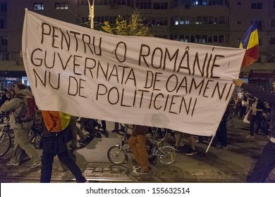 BUCHAREST, ROMANIA - SEPT 22: Unidentified people protest for the 22nd day against the plan to open Europe's largest open-cast goldmine in the Rosia Montana on Sept 22, 2013 in Bucharest, Romania.