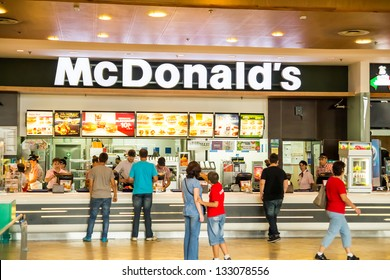 BUCHAREST, ROMANIA - SEPTEMBER 14: People buying fast-food from McDonald's Restaurant on September 14, 2012 in Bucharest, Romania. McDonald's is the main fast-food restaurant chain in Romania.