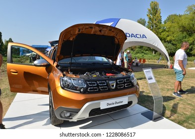 Bucharest, Romania - September 2, 2018: Car show of Romanian automobile manufacturer Dacia, which celebrated 50 years from the moment it's first car was produced. Off road model Dacia Duster exposed.