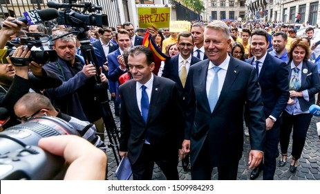 Bucharest, Romania - September 20, 2019: Klaus Iohannis (R), the president of Romania, leave after submitting his candidacy for the second presidential term at the BEC.