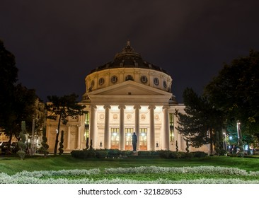 """BUCHAREST, ROMANIA - SEPTEMBER 26, 2015. The neoclassical building called """"Ateneul Roman"""" (Atheneum) usual place to host classical shows. George Enescu Festival. Night time."""