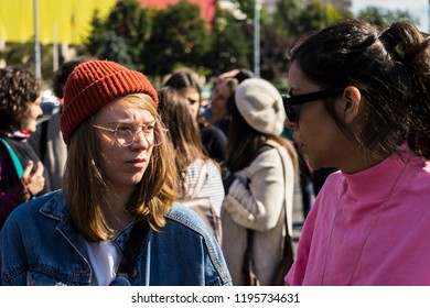 Bucharest, Romania, September 30, 2018. Girls gaze/two girls amidst a lgbtq+ protest to boycott the Romanian referendum on family composition within the constitution.