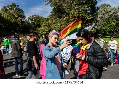 Bucharest, Romania, September 30, 2018. Gay people taking selfies amidst a lgbtq+ protest to boycott the Romanian referendum on family composition within the constitution.