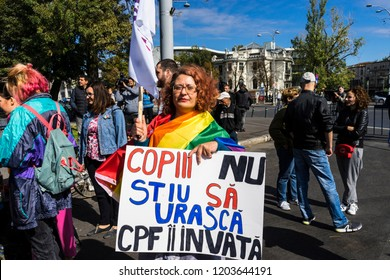 Bucharest, Romania, September 30, 2018. Gay activist woman holding a slogan banner during a lgbtq protest to boycott the Romanian referendum on family composition within the constitution.