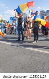 Bucharest, Romania-August, 10, 2018: Young people protest with the Romanian national flag in Victoria Square in front of  the Romanian Government against entrenched corruption in the country