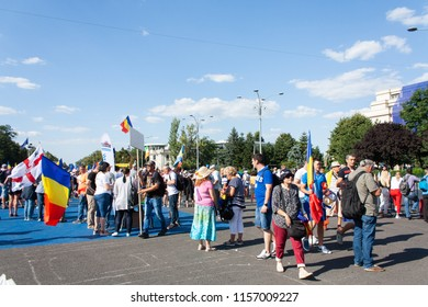 Bucharest, Romania-August,10,2018: People gather at the Romanian expats protest against corruption in Victoria Square, Bucharest with flags of the countries they work in.