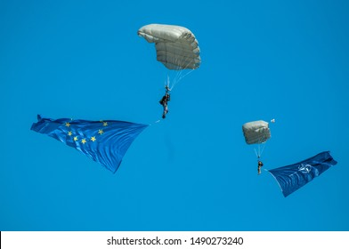 Bucharest/ Romania-August-24-2019:  Paratroopers with EU and NATO flags fly over crowd at Bucharest International Air Show