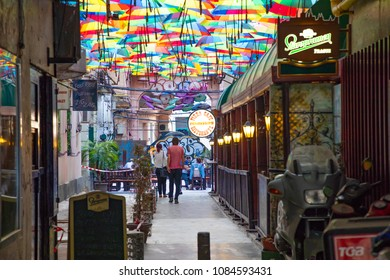 Bucharest, Rumania - 28.04.2018: Rainbow umbrellas roof street in Victory Passage , Bucharest