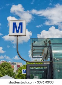 Bucharest subway sign and entrance on blue sky