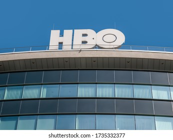 Bucharest/Romania - 05.16.2020: HBO logo on a modern glass building in Bucharest. Home Box Office televsion offices in Romania.