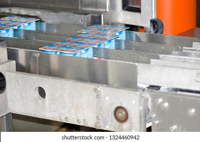 Bucharest/Romania -  June 18 2014: Industrial yoghurt packaging line at Danone Romania factory in Bucharest. The Groupe Danone is a French food-products multinational corporation.