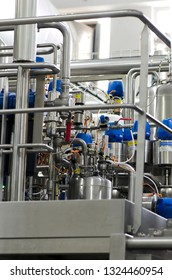 Bucharest/Romania -  June 18 2014: Pipes, valves and pressure tanks at Danone Romania factory in Bucharest. The Groupe Danone is a French food-products multinational corporation.