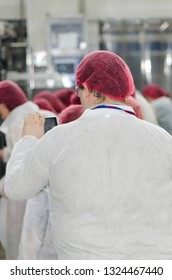 Bucharest/Romania -  June 18 2014: Visitors at Danone Romania factory in Bucharest. The Groupe Danone is a French food-products multinational corporation