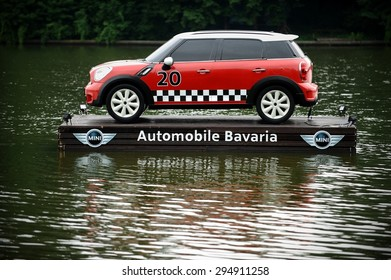 BUCHAREST/ROMANIA - JUNE 26: Advertising campaign with a Mini Cooper floating on a platform on a lake, on June 26, 2015 in Bucharest.