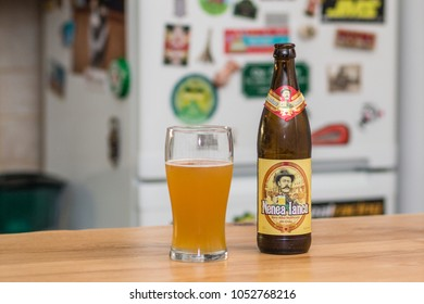 Bucharest,Romania - March 23, 2018: Nenea Iancu beer (sold in Romania by Bavarom) beer bottle isolated on table in a pub.