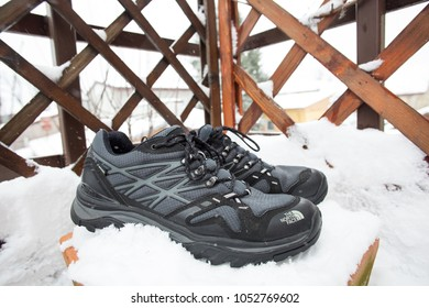 Bucharest,Romania - March 23, 2018: NorthFace trekking shoes isolated in snow.