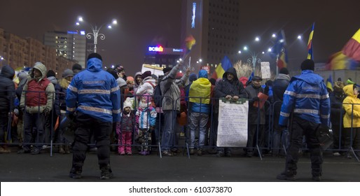 BUCHAREST,ROMANIA-FEBRUARY 12,2017:crowd gathered behind fence in Victory Square for protests against the social democrat government