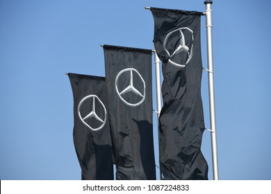 Buchholz, Lower Saxony / Germany - April 22, 2018: Flags at the entrance of a Mercedes store in Buchholz, Germany - Mercedes is a global automobile marque, a division of Daimler AG