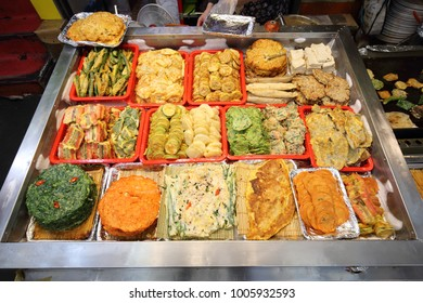 Buchimgae, Korean pancakes, and fried vegetables at a market in Seoul, South Korea.