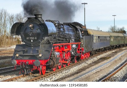 Buchlohe, Bavaria / Germany -  February 4, 2017: An old steam locomotive stops at Buchlohe station in Bavaria.