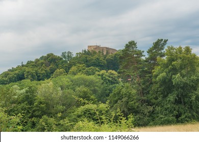 Buchlov castle in forest on a hill. Cloudy summer day in park Chriby, South Moravia, Czech republic, Europe